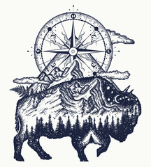 Bison double exposure, mountains, compass, tattoo art. Bison buffalo silhouette t-shirt design. Tourism symbol, adventure, great outdoor. Mountains, compass