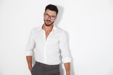 sexy young smart man standing with hand in pocket
