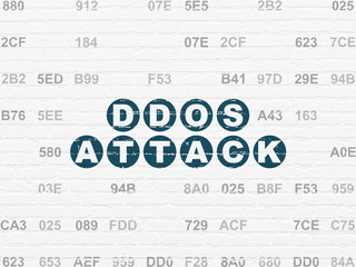 Protection concept: Painted blue text DDOS Attack on White Brick wall background with Hexadecimal Code