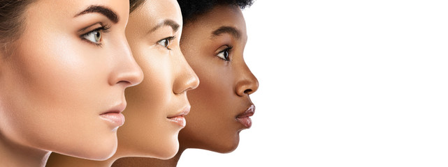 Different ethnicity women - Caucasian, African, Asian. Wall mural