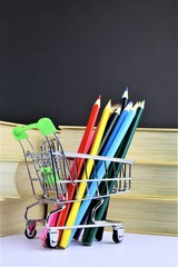 An concept Image of some colorful pencils with some books and copy space