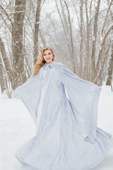 Beautiful girl  under the snowfall