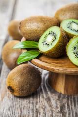 Ripe kiwi in a wooden dish