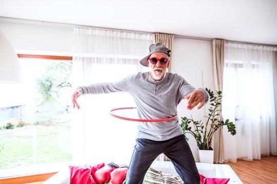 Senior man having fun at home.
