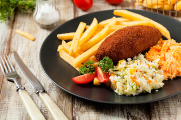 Chicken Kiev (de Volaille chop) with french fries and salads.