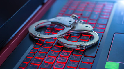 Handcuffs on the laptop,cyber crime concept