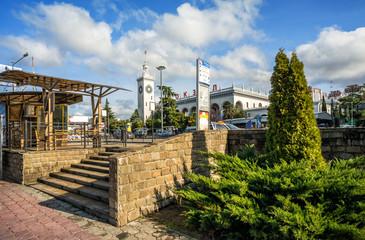 Железнодорожный Вокзал и южная растительность The tower of the railway station and the southern green vegetation