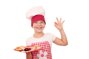 happy little girl cook with ok hand sign and sweet crepes
