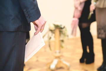 The groom holds a marriage certificate