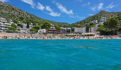 Mediterranean beach in summer in Spain on the Costa Brava, Catalonia, Canyelles Petites, Roses, Girona, seen from sea surface