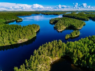 Printed kitchen splashbacks Lake Aerial view of blue lakes and green forests on a sunny summer day in Finland.