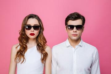 Serious loving couple wearing sunglasses.