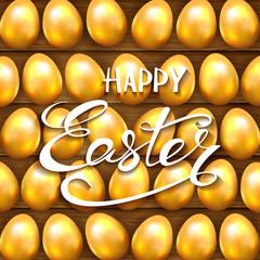 Golden Easter eggs on wooden background
