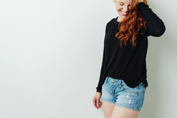 Sexy laughing young redhead woman