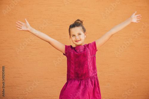 0c5e96581 Outdoor portrait of adorable preteen girl wearing pink summer dress ...