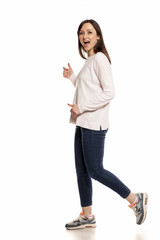 Profile of happy woman walking on white background