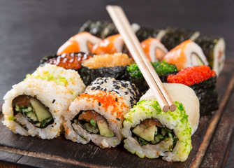 Japanese Sushi over black background.