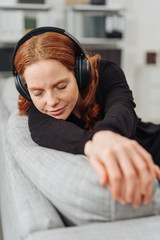Blissful young woman relaxing listening to music
