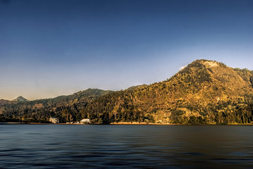 SARANGAN lake in Lawu highland, Central Java, Indonesia with clear blue sky.