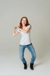 Jubilant young woman dancing and cheering