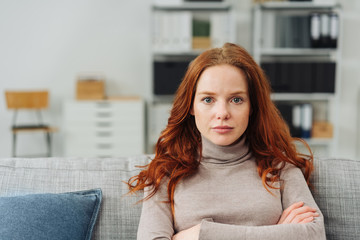 Thoughtful young woman staring intently ahead