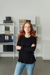 Serious confident young woman in an office