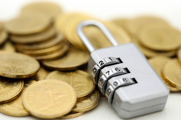 Master key with gold coins,business concept.