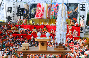Japanese dolls & ritual articles set displaying on tiered stand during the Grand Bonfire Ceremony of farewell memorial service of old, used dolls at the Japan Shinto shrine Close up, Magnified image 4