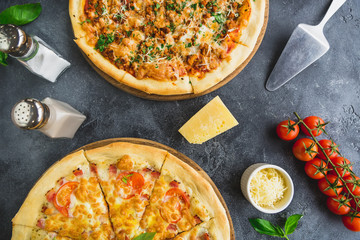 Pizza with bacon, cheese, tomato on dark background. Flat lay. Top view. Delicious food background