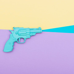 blue plastic gun on a colored background