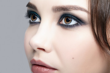 Closeup macro shot of  human female face. Woman with natural evening vogue face beauty makeup