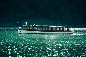 Traditional passenger boat on Königssee lake at sunset, Bavaria, Germany