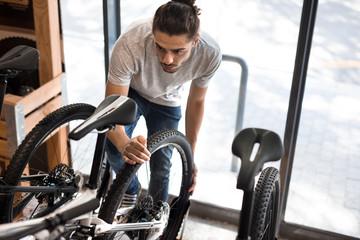 Man in a bicycle workshop