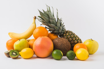 various fruits laying on white background