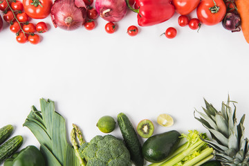 Border of green and red vegetables and fruits isolated on white background