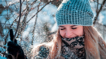 Young woman smiling in winter forest