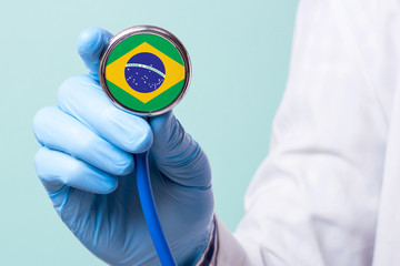 Medicine in brazil is free and paid. Expensive medical insurance. Treatment of disease at the highest level Doctor holding a stethoscope in his hand Wall mural