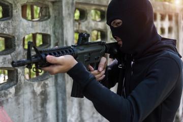 Commando with Helmet holding M16 gun