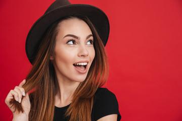 Close up of a joyful stylish girl wearing hat
