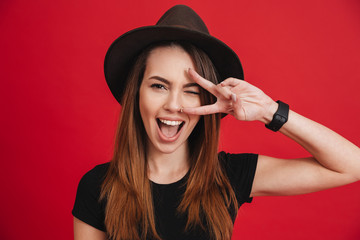 Close up of a cheery stylish girl wearing hat