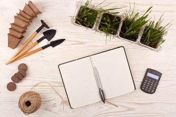 Gardening tools and seedlings..