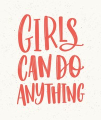 Girls Can Do Anything hand lettering written with red letters on light background. Inscription handwritten with elegant cursive font. Feminist or gender equality slogan, phrase. Vector illustration.