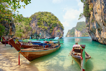 Beautiful landscape with traditional longtail boats, rocks, cliffs, tropical beach. Krabi, Thailand. Wall mural