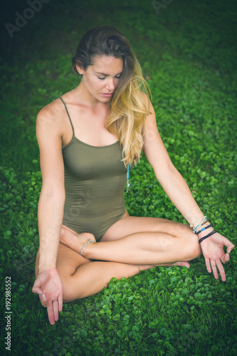quotrelaxed young woman sitting in the lotus position