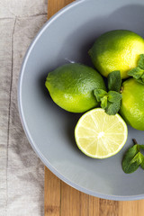 lime and mint in a plate top view.