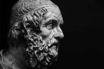 Head and shoulders detail of the ancient sculpture