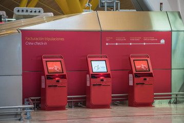 red self machines check-in service at the airport kiosk