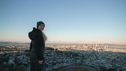teen girl enjoys sunset on Twin Peaks at Sun Francisco