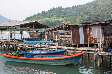 Houses on stilts and pier in the fishing village on Ko Chang island, Thailand.