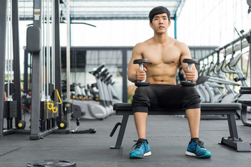 strong fitness man posing muscular body and doing exercises for bodybuilder in the gym, fitness concept, sport concept